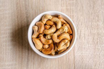 Close up cashew nuts on wooden background