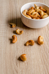 cashew nuts on wooden background