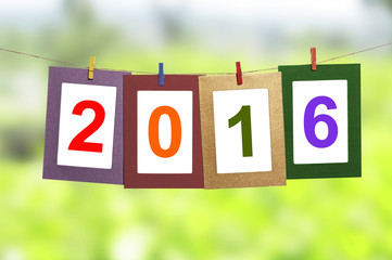 New year 2016 in photo frame hanging on clothesline