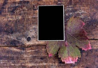 Photo frame on wooden desk