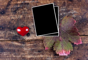 Photo frame with heart on wooden desk