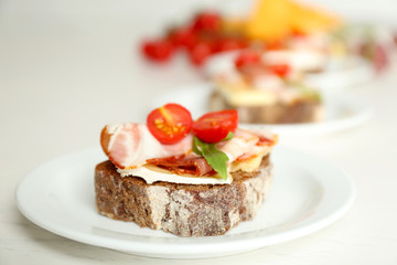Tasty sandwiches on plates, close up