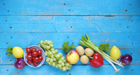 Healthy food. Vegetables and fruit on a rustic table, good copy space