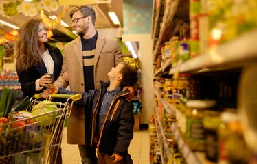 Young family in a grocery store