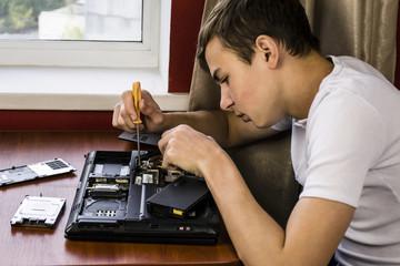 Teen disassembled laptop repairs