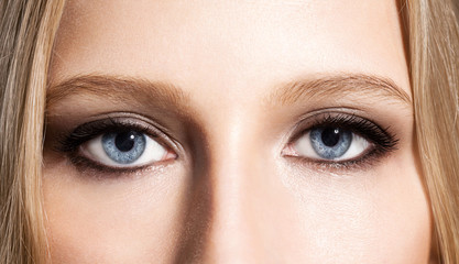 Eyes of the girl with an evening make-up and long black eyelashes
