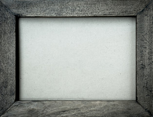 Vintage tone wooden frame with card board background