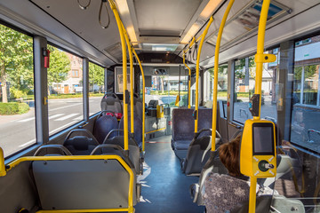 Interior of empty modern city bus in europe