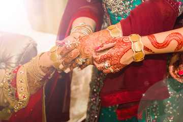 Indian bride getting gold ornaments. soft focus