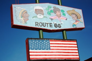 Flag and Route 66 sign in Arizona, USA