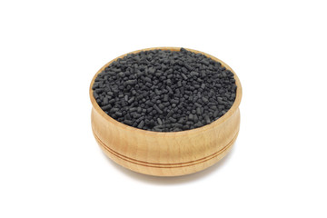 activated carbon granules in a wooden bowl