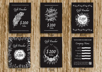 Vintage black and white gift voucher with hand drawn floral,feather and ink decoration for print.