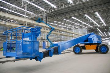 blue boom lift perspective indoor