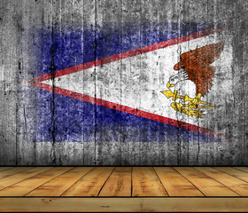 American Samoa flag painted on background texture gray concrete