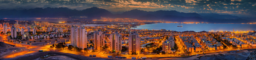 Nocturnal panaramic view on Eilat (Israel) and Aqaba (Jordan) cities at the northern part of the Aqaba gulf, Red Sea Wall mural