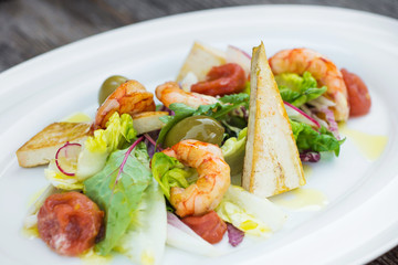 Prawns salad on a wooden background