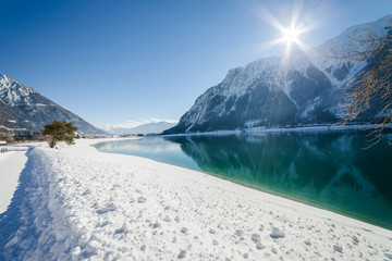 Winter landscape with mountain lake, Alps, Achensee, Austria.