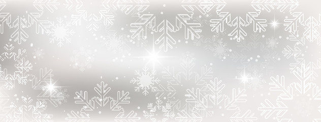 Winter wallpaper with snow, snowflakes and glowing stars.
