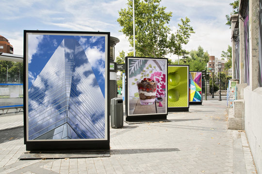 billboards with photographs at city street