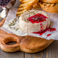 Camembert with berry jam, toast and thyme.