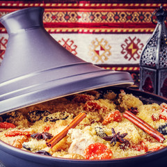 Traditional moroccan tajine of chicken with dried fruits and spi