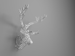 Artificial deer head hanging on the wall. Polygonal head of a