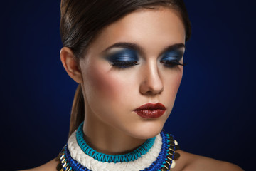 Fashion art portrait of beautiful woman with bright make up. Vog