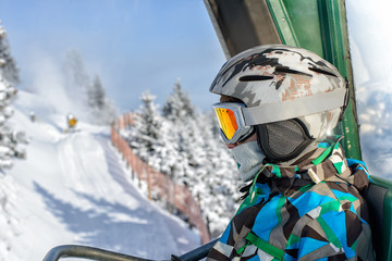 boy in a mountain-skiing helmet and points is represented on the