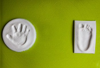 Baby handprint and footprint with copy space. New life concept
