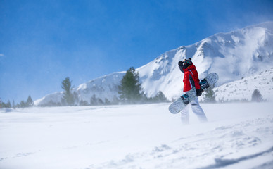snowboarder against panoramic winter mountains