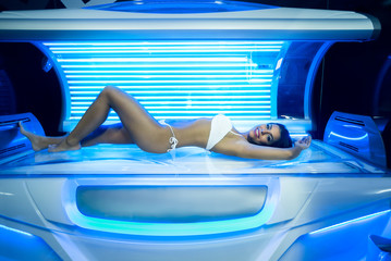 young woman in modern solarium