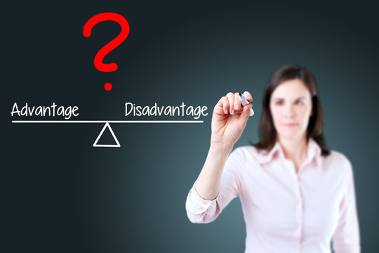 Young business woman writing advantage and disadvantage compare on balance bar. Blue background.