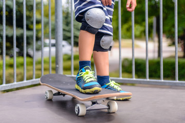 Young boy with his skateboard on a ramp