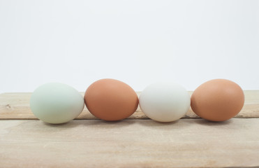Still Life- eggs laid on a wooden plane white background.