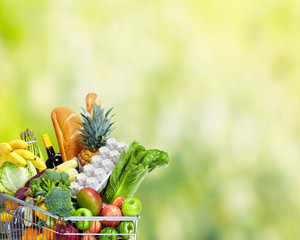 Wall Mural - Grocery shopping cart with vegetables.