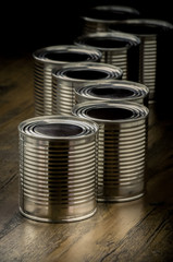 Tin cans for food on wooden background, Selective focus and color effect