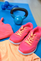 Gym shoes - Fitness outfit closeup with kettlebell