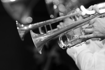 Trumpets in the orchestra closeup in black and white