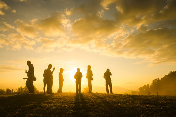 Group Of People standing with Sunrise Concept