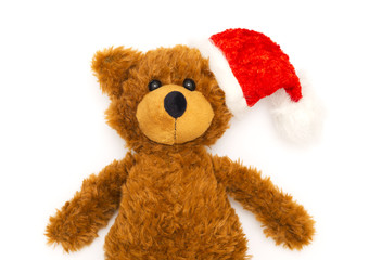 vintage teddy bear with santa hat on white background, christmas decoration