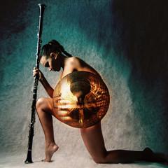 Fashion studio shot of beautiful woman in armour