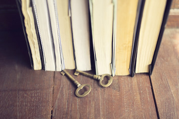 Books and keys on a wooden floor