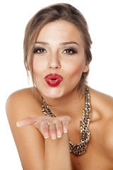 beautiful young woman with pursed lips and a necklace
