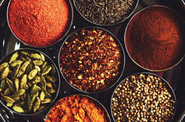 Photo sur Plexiglas Herbe, epice Rack with traditional indian spices for cooking - cardamom, turmeric, cumin, coriander seeds, cinnamon and chili