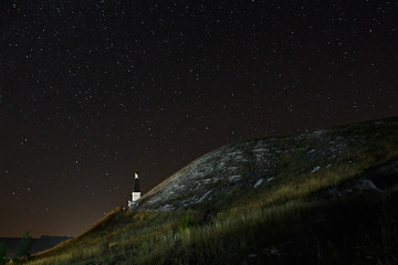 Orthodox Monastery on the background of stars in the night sky.