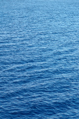 Blue water surface with strong wind