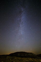 Starry sky and Milky Way on a background of hill.
