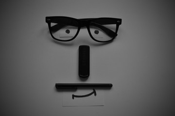 Movember symbol, pen, glasses USB