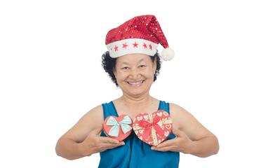 Portrait of asian senior woman holding gift box on white background
