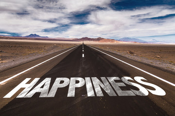 Happiness written on desert road